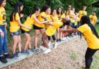 students balance on log in iowa edge team-building exercise