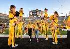 students file between cordon of spirit squad members during on iowa kickoff at kinnick