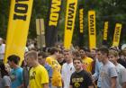 new students file past iowa banners during convocation and block party 2019