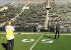 Colleagues from the UI College of Pharmacy paused for a photo on the Kinnick Stadium 50-yard line during a group tour arranged by We Are Phil committee members in the college. Hawkeye Football is one of many programs on campus that receives charitable con