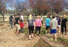 Students help with an urban garden in a park.