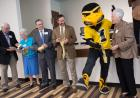 Sally Mason cuts the ribbon of the newly-dedicated Mary Louise Petersen Residence Hall.
