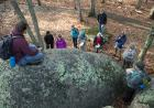 Matt Trembath, a UI geology major and U.S. Air Force veteran, peers down at his fellow geology students at Elephant Rocks State Park.