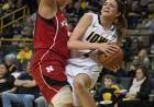 Ally Disterhoft draws contact in the paint.