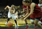 Junior Kali Peschel hustles after a loose ball. Peschel delivered a crucial five points and four rebounds off the bench.
