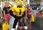 people with herky statue