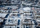 Aerial view of snow covered campus.