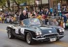 Interim President Jean Robillard rides in the Homecoming Parade.