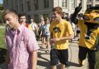 Students walk to president's block party.