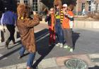 Texas fans take a picture with the Cal Bear on the Pedestrian Mall.