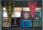 Flags from teams represented at the meet hang in the CRWC.