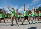 flash mob dancers in lime green attire