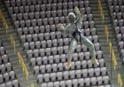 Captain Rodney Bunyan lowers himself to the court during a rappelling practice.