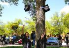"""""""con-GRAD-ulation"""" by Soo Kyum Kim received first place in the international student Show us your Hawkeye Spirit category. The photo shows two of the photographer's favorite fellow Hawkeyes outside Carver-Hawkeye Area. Kim is a psychology major from Dae"""