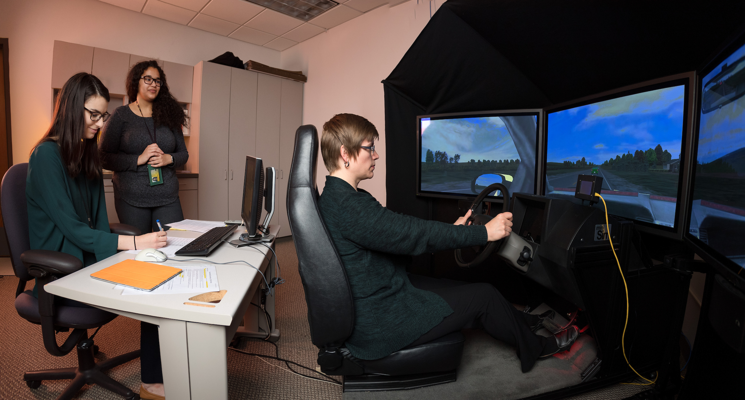 students working on driving simulator