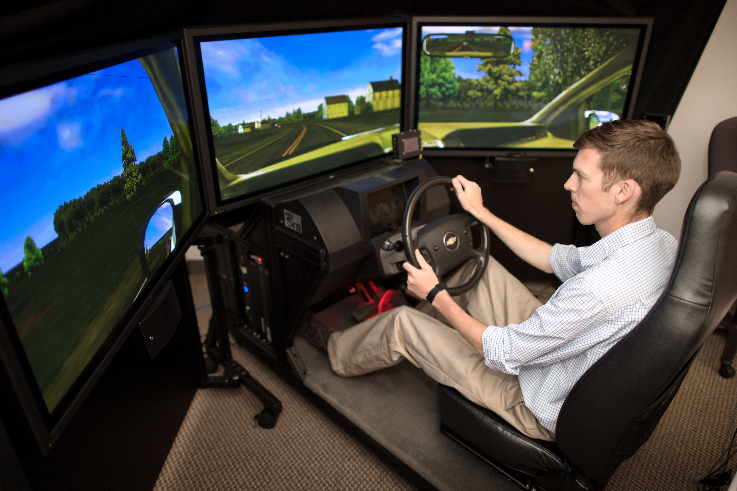 student working in driving simulator