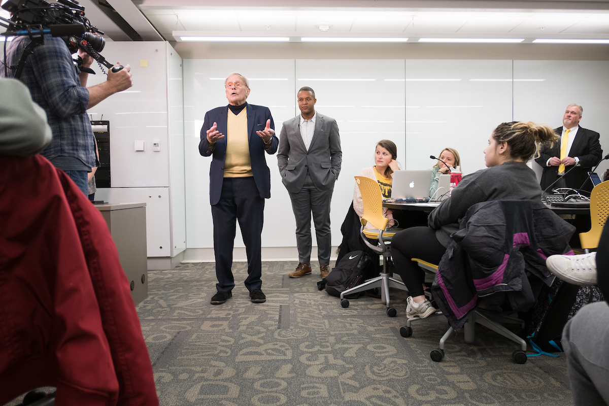 tom brokaw and craig melvin in UI classroom