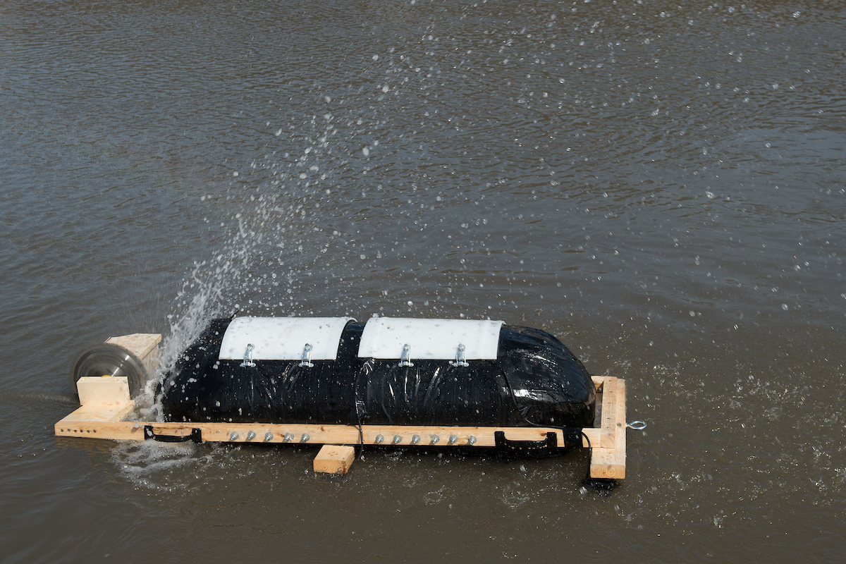 Michael Simon's invention, the RC Beaver, floats in the waters of the Iowa River, its debris-cutting saw blades whirring
