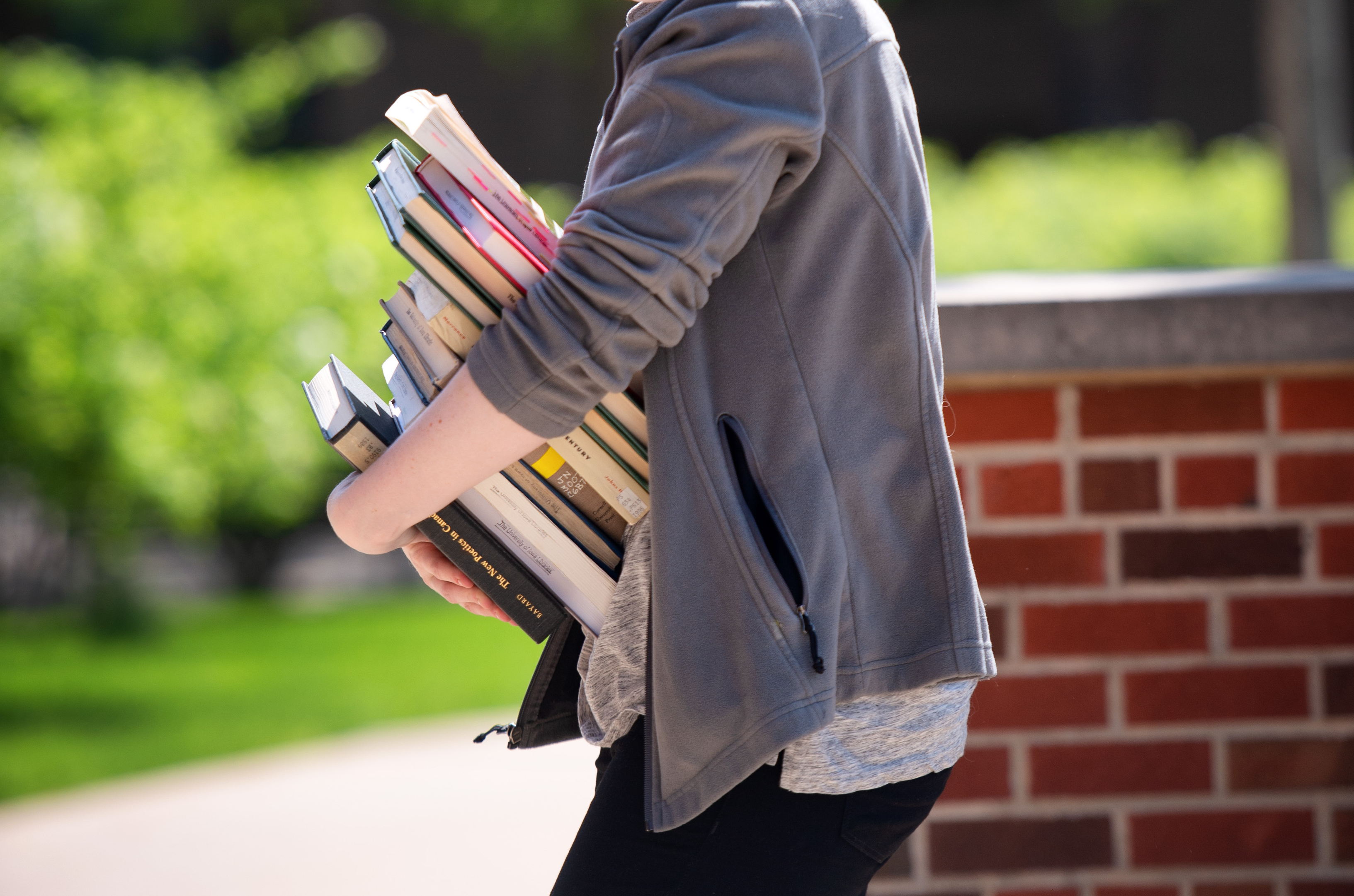 student carrying way too many books