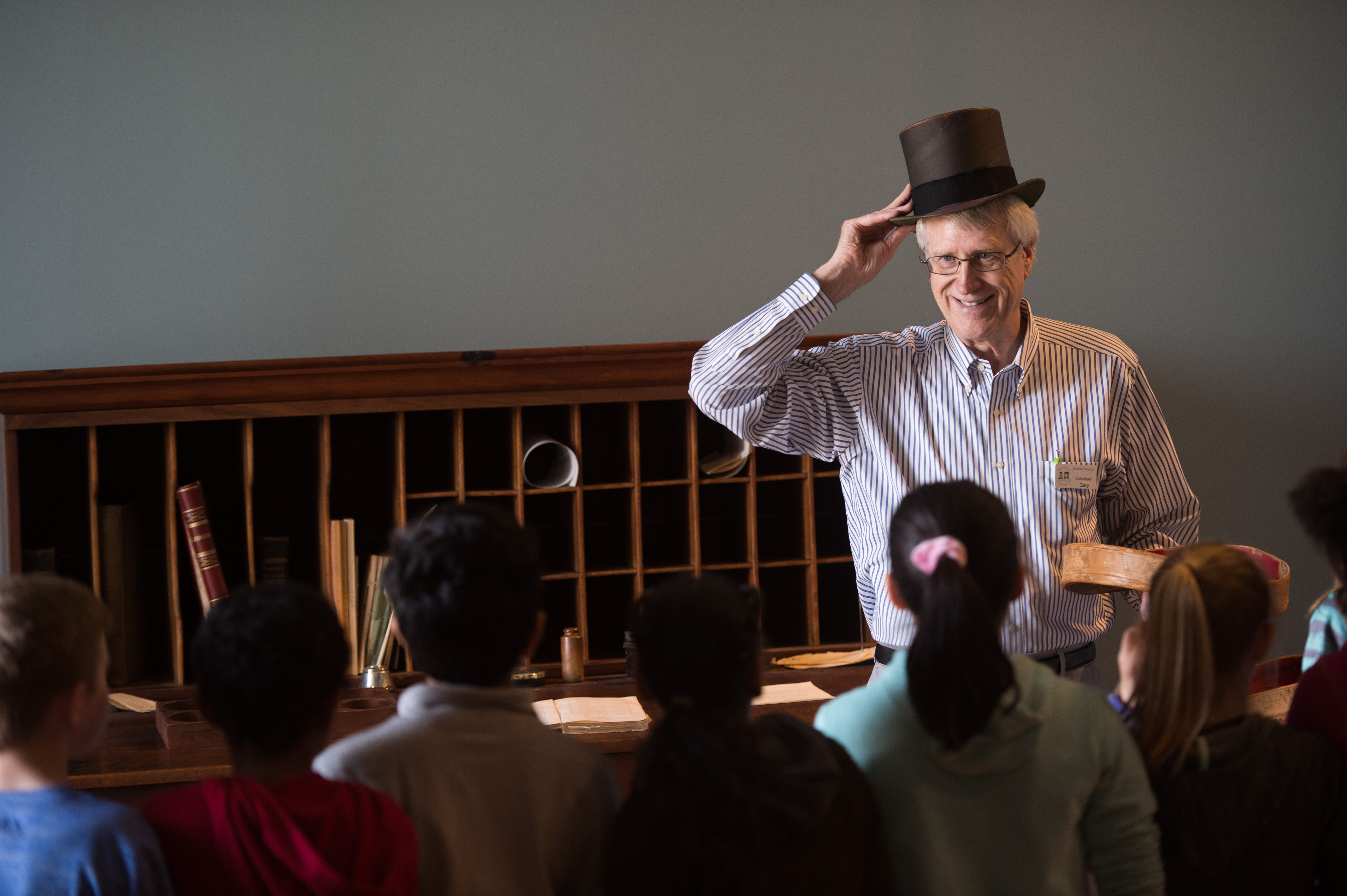 old capitol tour guide with top hat
