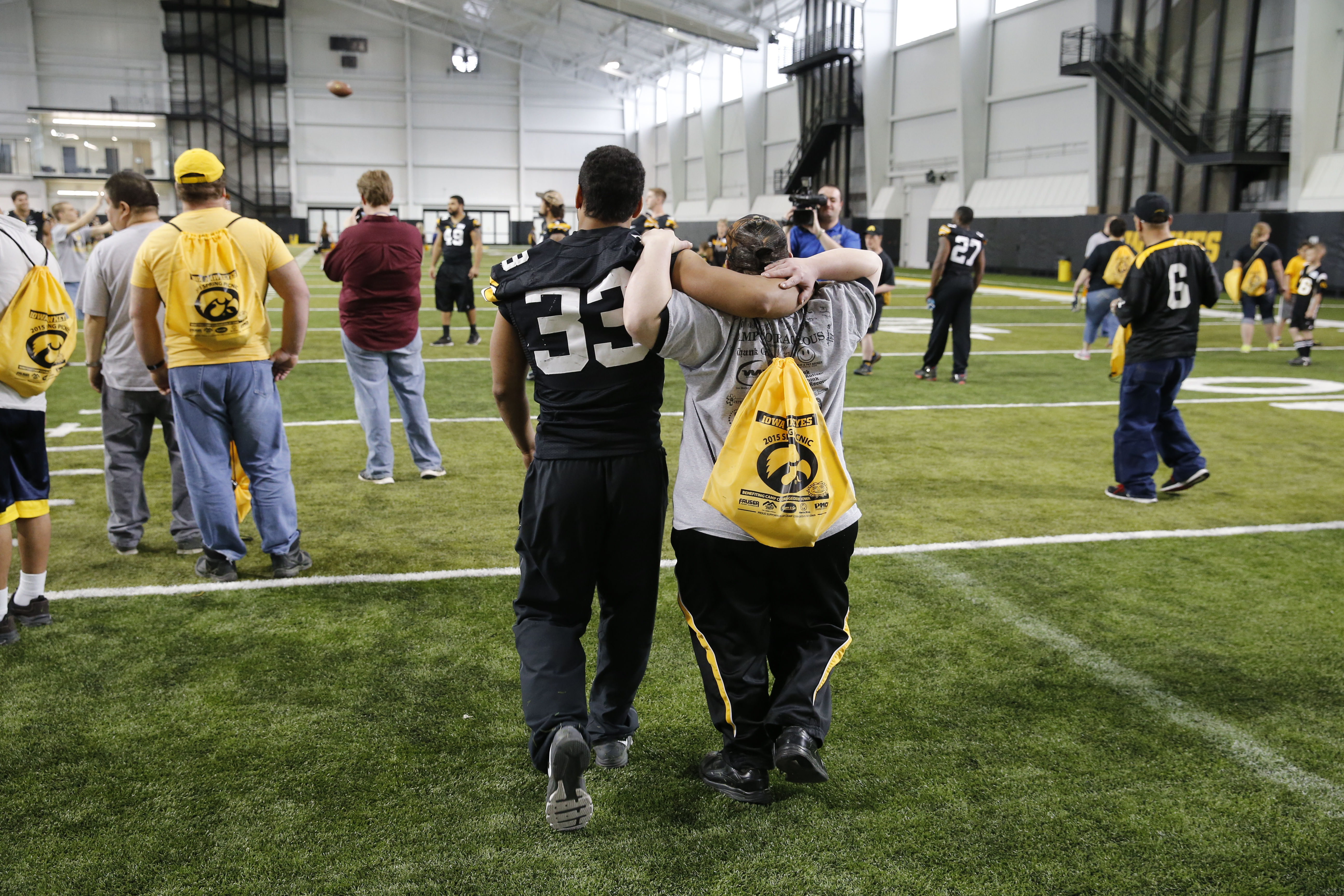 Jordan Canzeri walks with a member of Camp Courageous earlier this spring