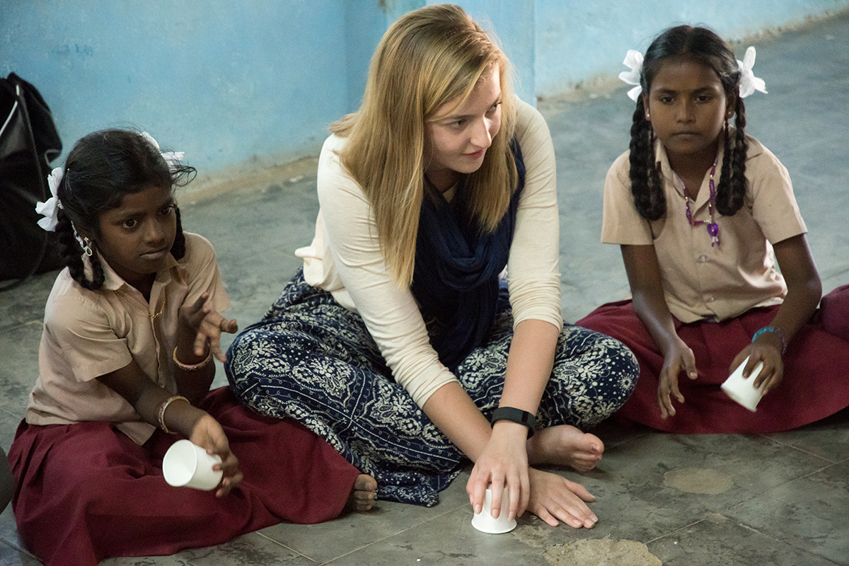 ui student interacting with children in india