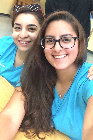 andrea diaz with fellow intern at school volunteer event