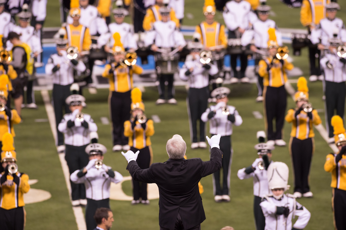 Kevin Kastens conducts the Iowa and Michigan State bands
