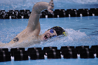 A student swims laps at the UI Campus Recreation and Wellness Center.