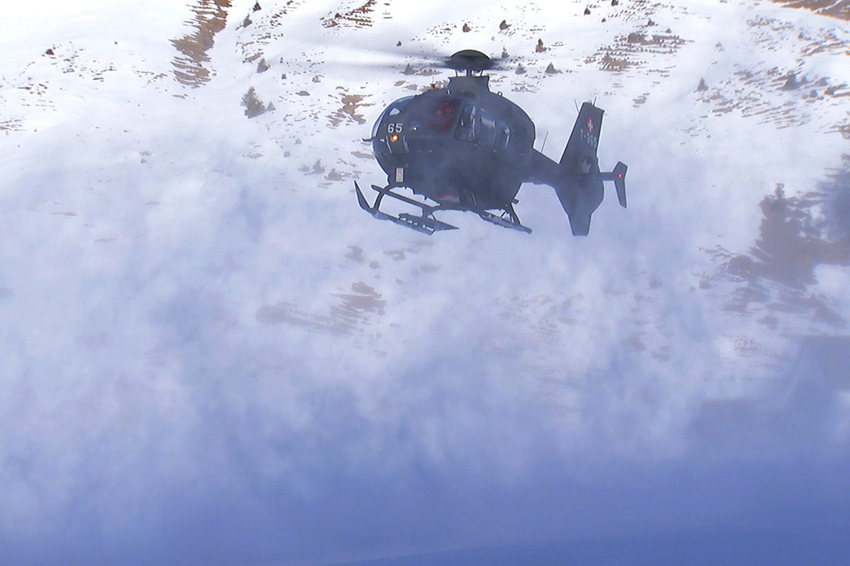 helicopter flying in whiteout conditions