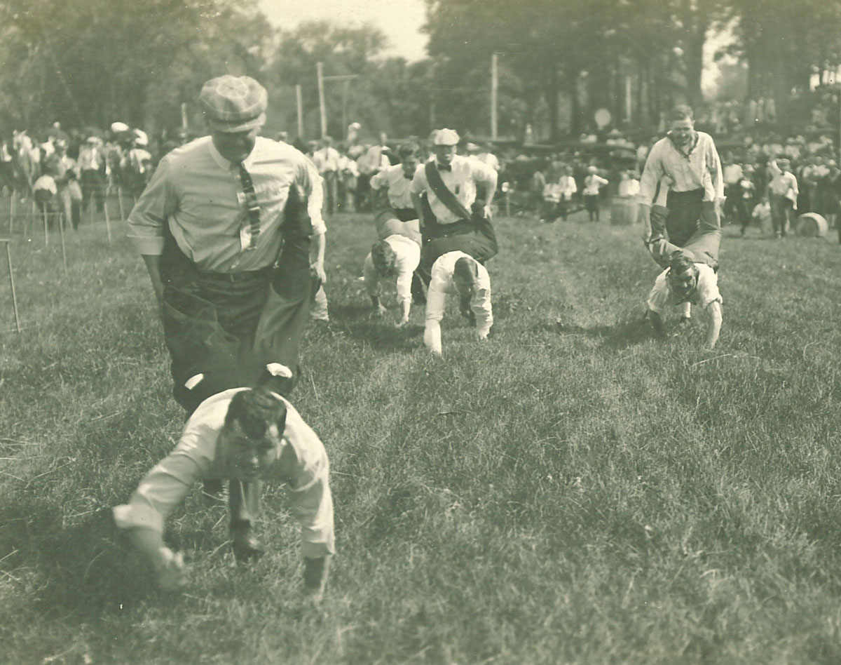 Human wheelbarrow race at City Park for Senior Frolic, 1910s