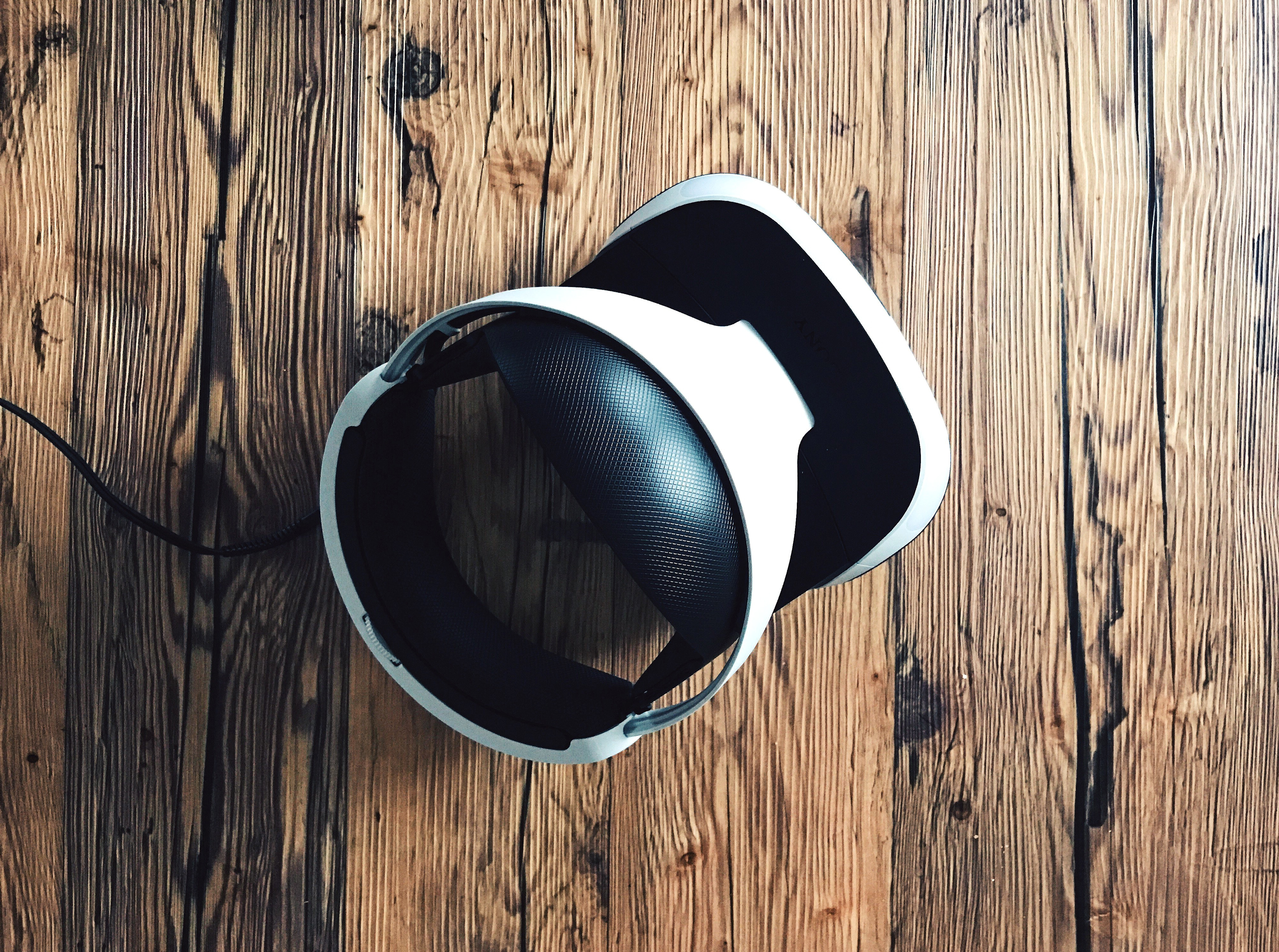 vr goggles on wooden floor