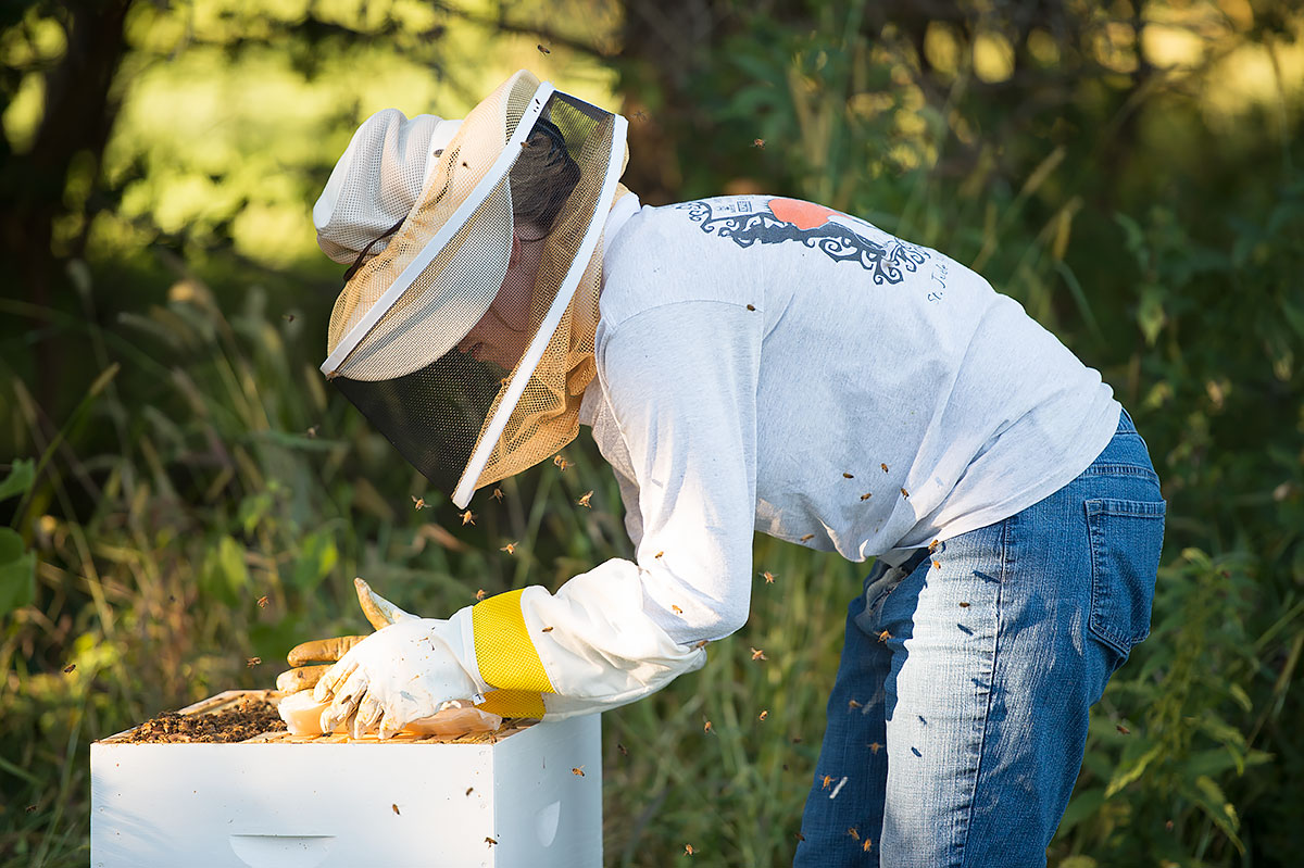 kelli haught at her home working with bees